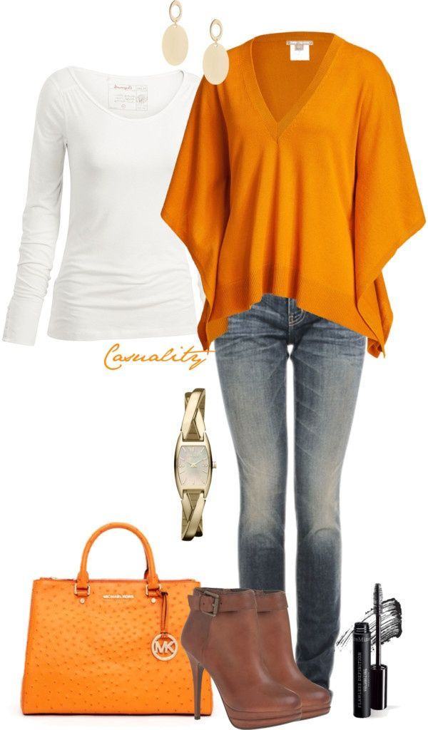 I love this beautiful top with the white shirt underneath. Not a fan of the jeans and to thin heeled booties though.