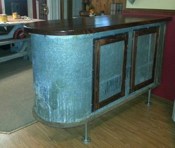 Upcycled galvanized water trough now an awesome industrial rustic bar height kitchen Island.