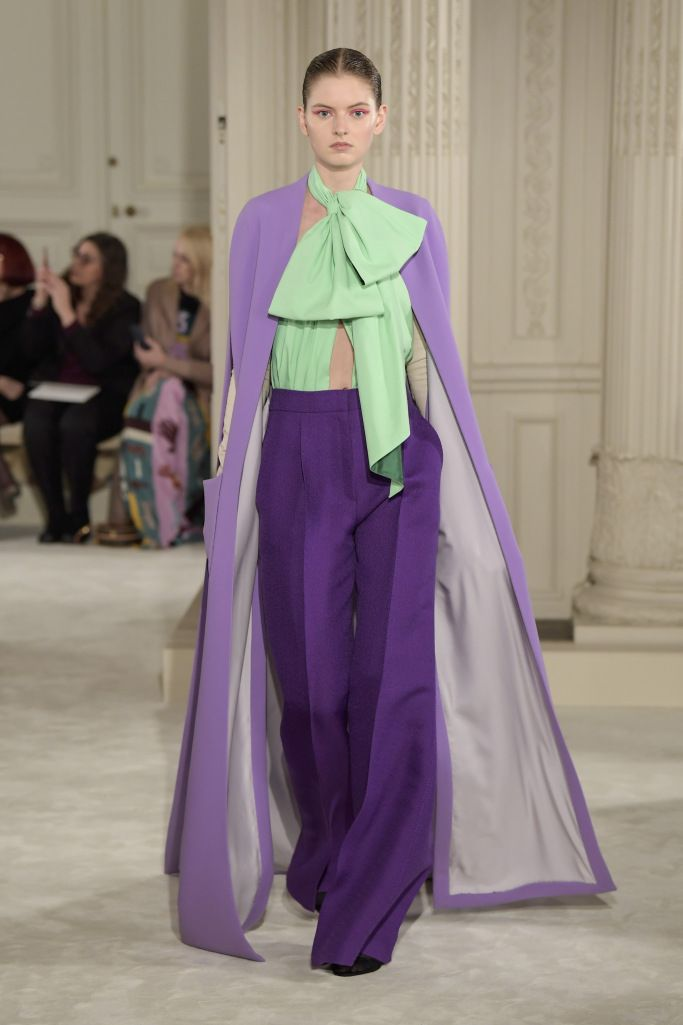 Iris cape over purple trousers and mint green keyhole top with bow tie - Paris Couture Fashion Week Spring 2018 - Paris Couture Fashion Week Spring 2018 | Valentino appraises the future of haute couture