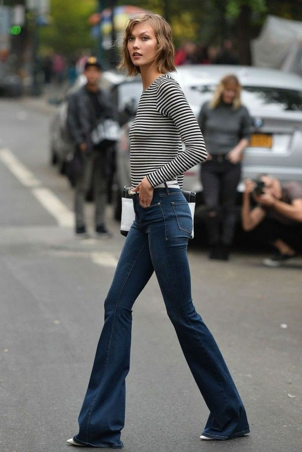 Karlie Kloss in a striped tee + high-waisted flared jeans + white heels