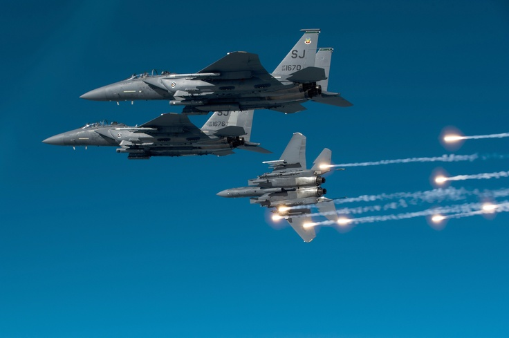 F-15s training mission  Flares are released from an F-15E Strike Eagle during a local training mission Dec. 17, 2010, over North Carolina. The F-15E is from the 335th Fighter Squadron from Seymour Johnson Air Force Base, N.C. (U.S. Air Force photo/Staff Sgt. Michael B. Keller): Aviation, Military Aircraft, Air Force, F15, Aviones Airplanes, Eagles, Fighter