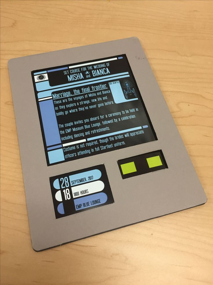 Wedding invitations modeled after the PADD from Star Trek: The Next Generation. The invitation is printed on photo paper and sandwiched between two pieces of gray matte board.
