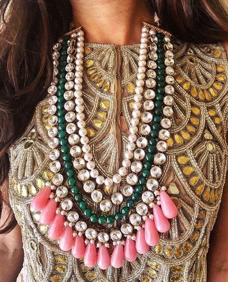 Love this fashion forward pairing of a colorful necklace and saree blouse