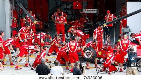 SEPANG, MALAYSIA - APRIL 8: Scuderia Ferrari F1 Team pit crew practice tire change in the pit-lane on the first practice day of the Petronas...