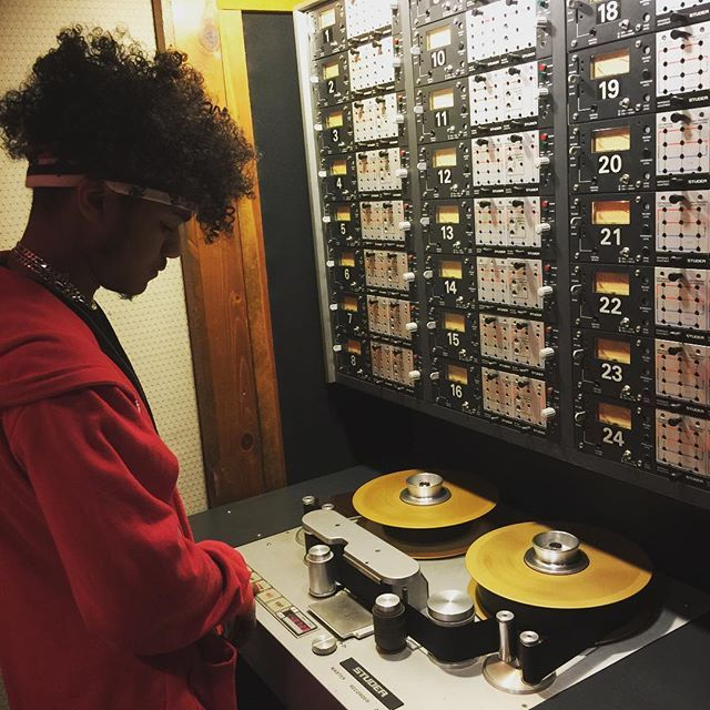 Student loading the tape machine in order to work on a mix in Studio C! #omega #studios #school #audio #engineering #analog