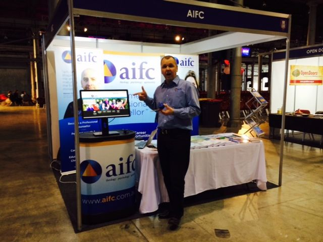 Our CEO Nicholas Marks setting up the aifc information stand in preparation for the OneLove Conference in Sydney .  2nd August 2014.