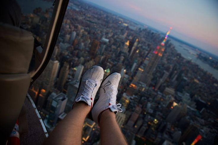 NYC Empire State Building Rainbow Pride Week Shoe Selfie with FlyNYON. Doorless Helicopter Flights taking Aerial Photography to New Heights!