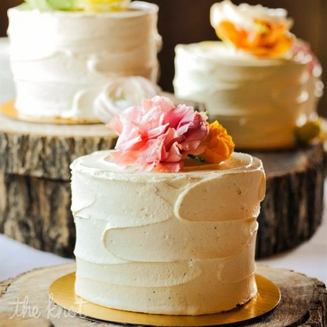 "David and I will most likely be this indecisive:  ""Katie and Dan couldn't decide on just one flavor, so they chose to have multiple smaller cakes! Various shades of roses topped each confection to distinguish each"""
