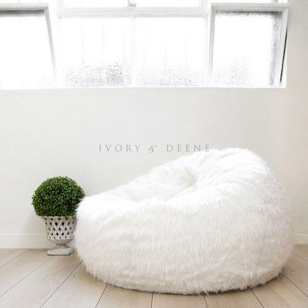 large shaggy white fur beanbag under a vintage window