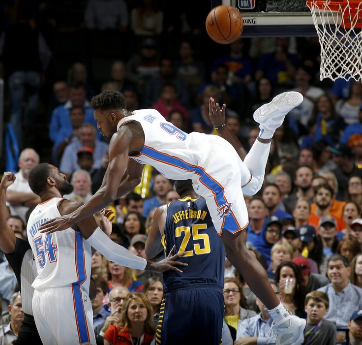 Oklahoma City's Jerami Grant (9) flies over Indiana's Al Jefferson (25) as Patrick Patterson (54) watches during an NBA basketball game between the Oklahoma City Thunder and the Indiana Pacers at Chesapeake Energy Arena in Oklahoma City, Wednesday, Oct. 25, 2017. The Thunder won 114-96. Photo by Bryan Terry, The Oklahoman