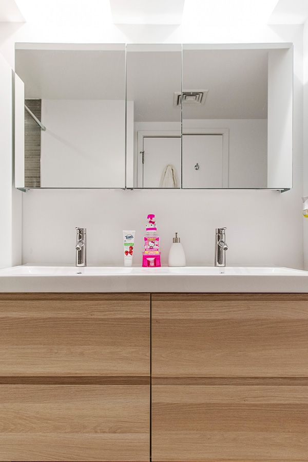 Paneled medicine cabinets and a double vanity provide plenty of storage space in a bathroom!