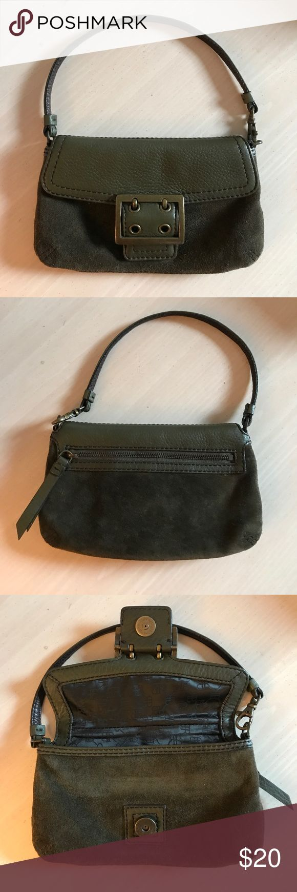 "Banana Republic Olive Green Wristlet Olive green suede wristlet from Banana Republic. 8"" x 5"" has two slots for credit cards inside and a zipper pocket outside. Buckle is for looks. It's actually a magnetic snap close. The strap can clip into two places for two different looks. Excellent condition! Banana Republic Bags Clutches & Wristlets"