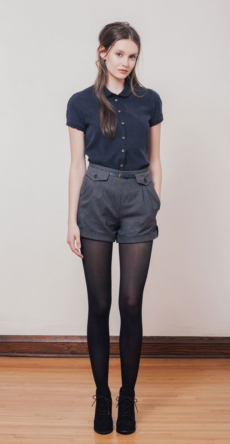 VIRGINIA Navy: Short-sleeved blouse in Tencel with small rounded collar and decorative slit at cuff. BETH Grey: High-waisted shorts in herringbone twill with side pockets and decorative front flaps. Betina Lou Fall-Winter 2014-15.