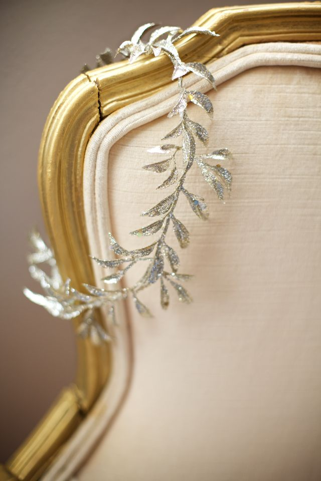 A simple piece of shimmery garland across the back of a chair, so typical of the season.