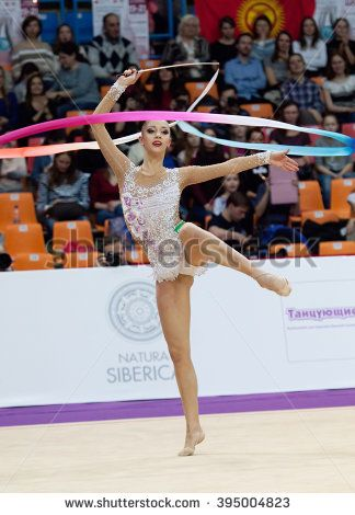 MOSCOW, RUSSIA - FEBRUARY 20, 2016: Irina Annenkova, Russia, on Rhythmic gymnastics Alina Cup Grand Prix http://www.shutterstock.com/pic.mhtml?id=395004823  #acrobatic, #activity, #adult, #aerobics, #annenkova, #athlete, #background, #beautiful, #beauty, #body, #caucasian, #champions, #color, #cup, #dancer, #elegance, #exercising, #female, #flexibility, #floor, #girl, #grace, #gymnastics, #healthy, #human, #image, #lifestyle, #motion, #one, #pantyhose, #people, #performance, #performer…