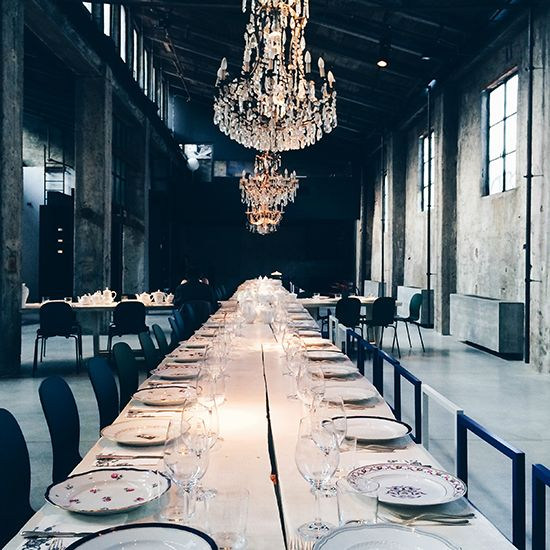 Carlo e Camilla in Segheria | An old sawmill was turned into a restaurant with a big table to accommodate the diners.