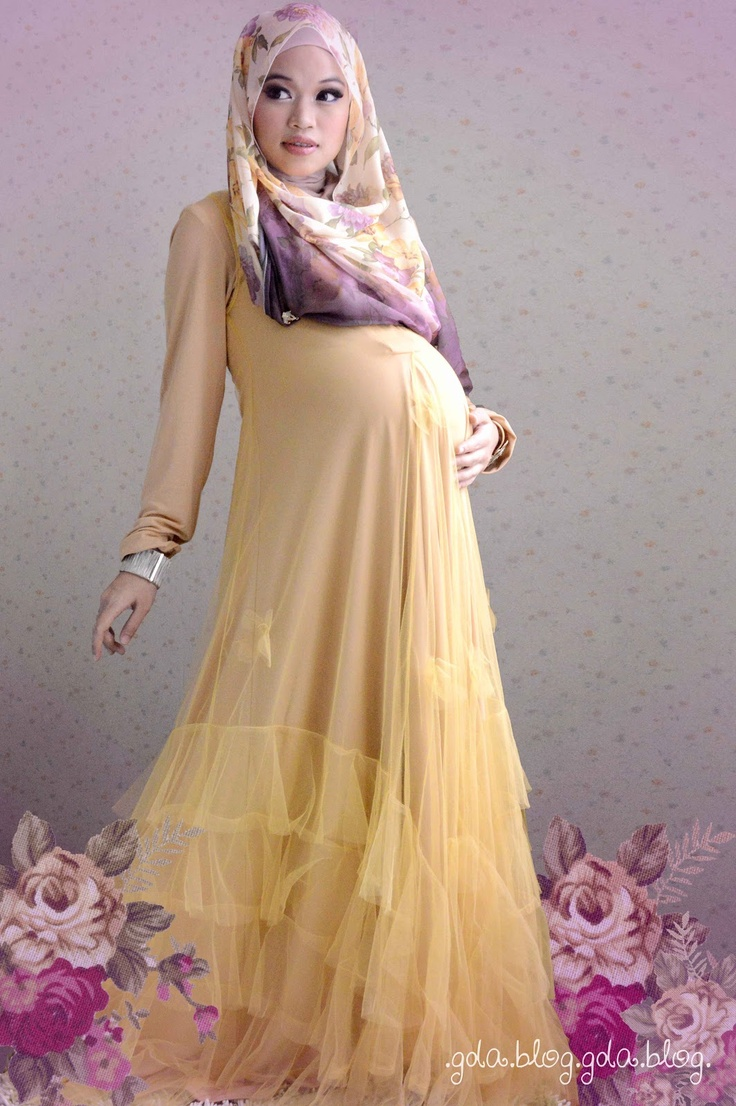"""long dress by Ghaida Tsuraya and """"calon bayi""""."""