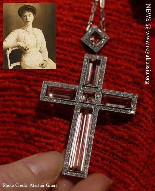 THE ROMANOVS JEWELRY ~ Grand Duchess Olga Alexandrovna's Faberge Cross Pendant ~ A diamond and topaz platinum mounted Faberge cross pendent purchased by the Tsar Nicholas II and the Empress Alexander Feodorovna in St Petersburg in 1912 bought for the Tsar's sister Grand Duchess Olga Alexandrovna was seen during a press preview at Christie's auction house in London. It was expected to fetch some 50-70,000 pounds (US$ 79-111,000 , euro 61-86,000) when sold at auction on Nov. 26., 2012