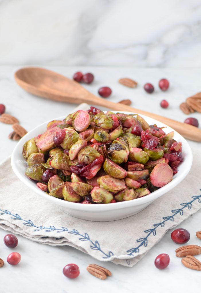 Roasted Brussel sprouts with pickled cranberries and pecans is a perfect Thanksgiving side but also an easy winter weeknight dish.