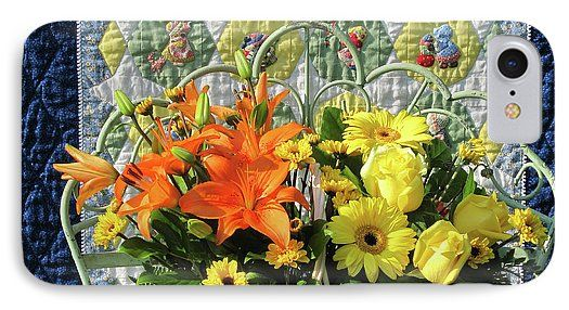 "This new phone case is on the website Pixels, for all sizes of phones. Protect your phone with an impact-resistant, slim-profile, hard-shell case. The image is printed directly onto the case and wrapped around the edges for a lovely presentation. ""Orange and Yellow Delights"" has an image of flowers and a Sunbonnet Sue quilt, photograph © Nancy Lee Moran. Flowers include yellow roses, yellow daisies, and orange lilies. #NancyLeeMoran #phone #iPhone #SunbonnetSue"