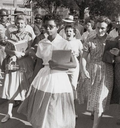 Little Rock desegregation [1957]   This is another iconic image of the 50's segregation period. Elizabeth Eckford is one of the African American students known as the Little Rock Nine. On September 4, 1957, she and eight other African American students attempted to enter Little Rock Central High School, which had previously only accepted white students. They were stopped at the door by Arkansas National Guard troops called up by Arkansas Governor Orval Faubus. They tried again without…
