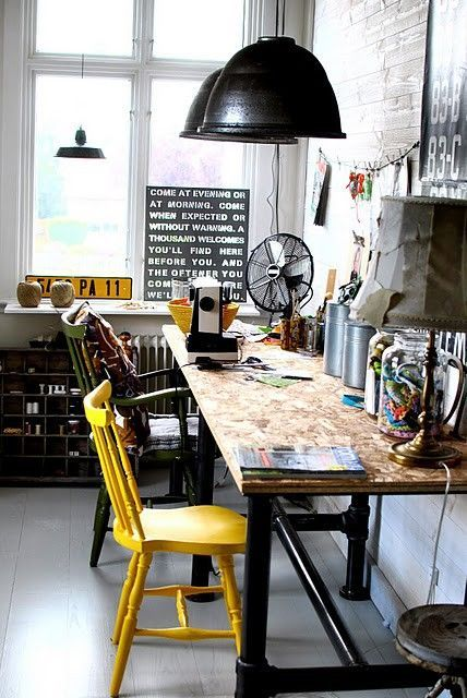 We love this industrial workspace, with upcycled desk, painted wooden chairs, industrial pendant lights and typographic walls!