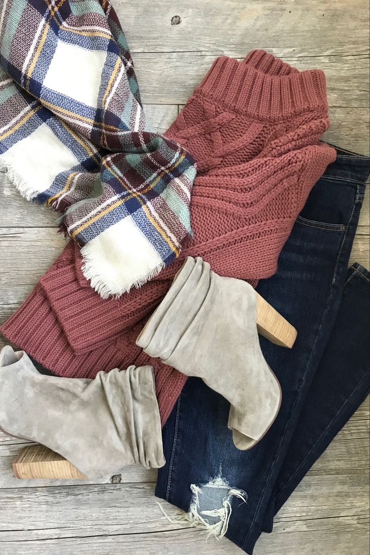 Distressed jeans, off the shoulder slouchy sweater, slouchy booties, and a plaid scarf make for the perfect fall outfit. Click to shop!