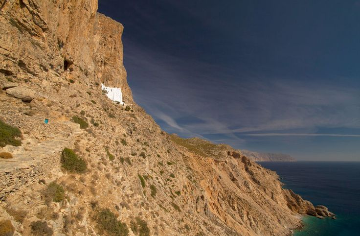 The monastery of Hozoviotissa, built into the face of a cliff, provides a breathtaking view of the sparkling blue waters of the Aegean Sea.
