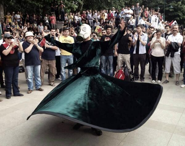 whirling dervish with gas mask, Istanbul #OccupyGezi