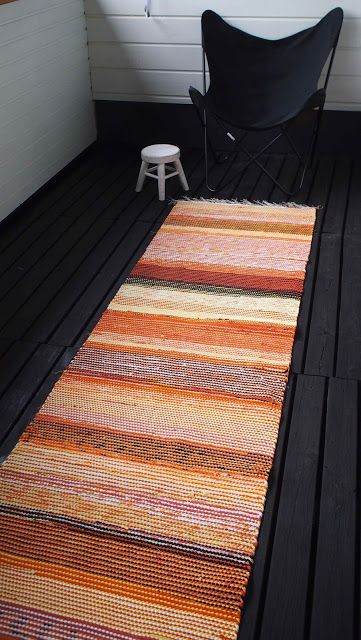 Liljan Lumo: Orange rag rug designed and made by Liljan Lumo/ Tiina Lilja Oranssi räsymatto terassille.
