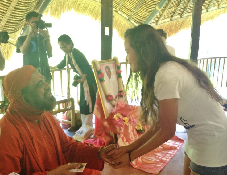 Swami Purnamritnanda visiting Green School and giving lessons in smiling.
