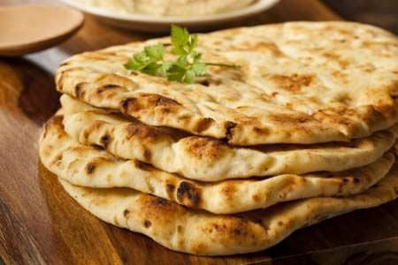 Soft Gluten Free Garlic Oven-Baked Naan (or stovetop version) Recipe: http://glutenfreerecipebox.com/gluten-free-garlic-naan-oven-baked-or-stovetop/ #glutenfree #indian