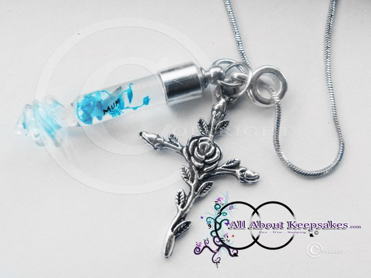 Glass Blue Twister Cylinder with Rice Writing  inside and gorgeous rose metal cross and necklace, allaboutkeepsakes.com