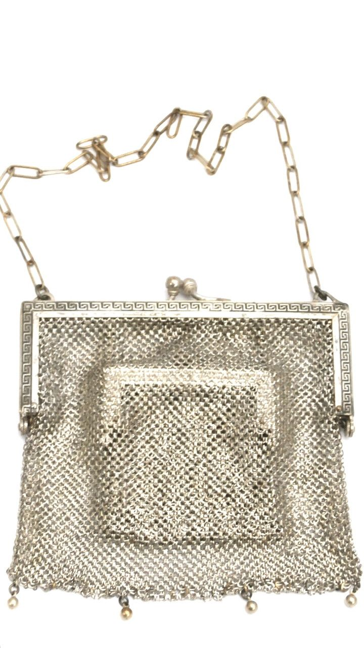 This antique metal mesh purse is made of German silver, and has some great Greek designed on the frames. The most unique part of this purse is the inside mini mesh bag, that looks exactly like the lar