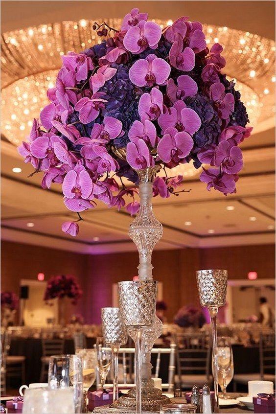 orchid and hydrangea centerpieces purple wedding ideas indoor reception / http://www.himisspuff.com/tall-wedding-centerpieces/2/