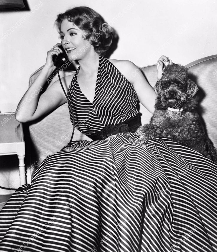 photo Arlene Dahl on the phone with her dog standing by dp-0041