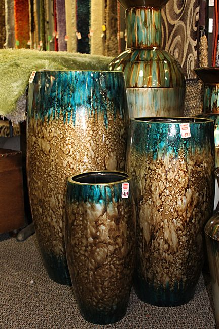 brown and turquoise vases.. I like them (: what the heck would I put in them…