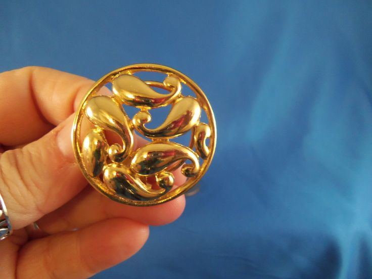A personal favorite from my Etsy shop https://www.etsy.com/listing/89509808/vintage-round-gold-scarf-clip-a32