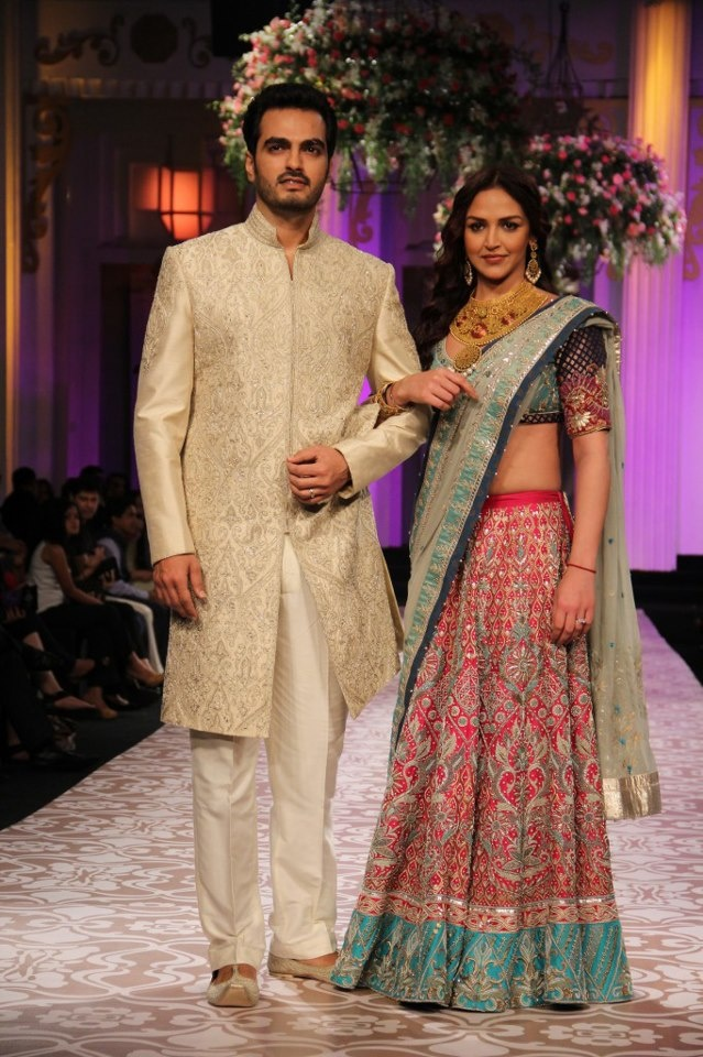 Esha deol with her husband in aneeta dongry,i like the sherwani and then emb on th sleeve....tone on tone looks nicer for men