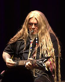 """David Allan Coe (born September 6, 1939) is an American outlaw country music singer who achieved popularity in the 1970s and 1980s. As a singer, his biggest hits were """"Mona Lisa Lost Her Smile,"""" """"The Ride,"""" """"You Never Even Called Me by My Name,"""" """"She Used to Love Me a Lot,"""" and """"Longhaired Redneck."""""""