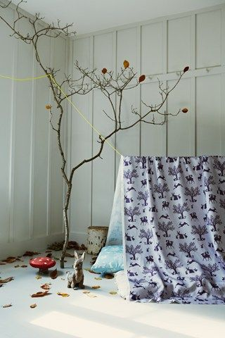 Want a fake, leaf less tree with big branches to hang nick nacks off.  A circular seat at the base (books stored underneath seat/bookcase seat) so the tree acts as a reading nook.