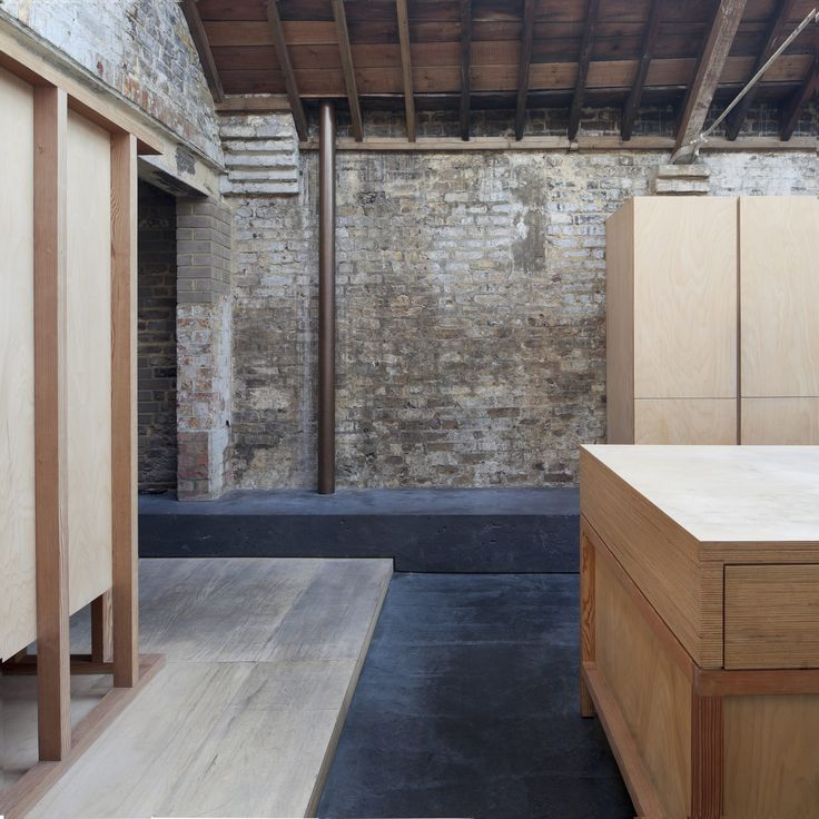 Collage House | Jonathan Tuckey Design, West Kilburn, London, UK- Dark polished concrete flooring and birch plywood kitchen joinery placed within the existing fabric of the building.