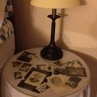 Family photo display~I would love to do this with my white wicker coffee table!