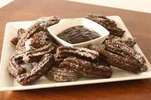 Chocolate Churros recipe - Churros with double the chocolate: in the batter and in the sauce. Make a batch for your next fiesta.