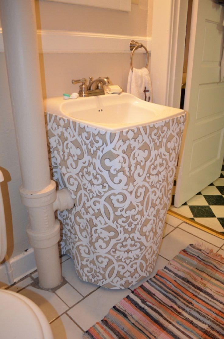Neutral Fabric Sink Skirt - good idea for exposed plumbing. Definitely like the pleasted look better