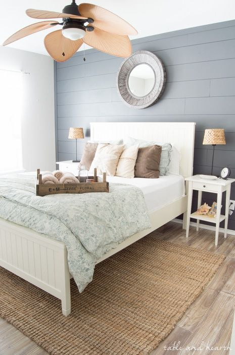 GORGEOUS!! Installing your own shiplap can be super easy! This is a great tutorial by Table & Hearth for how to install a DIY shiplap planked wall using simple plywood underlayment. http://www.tableandhearth.com