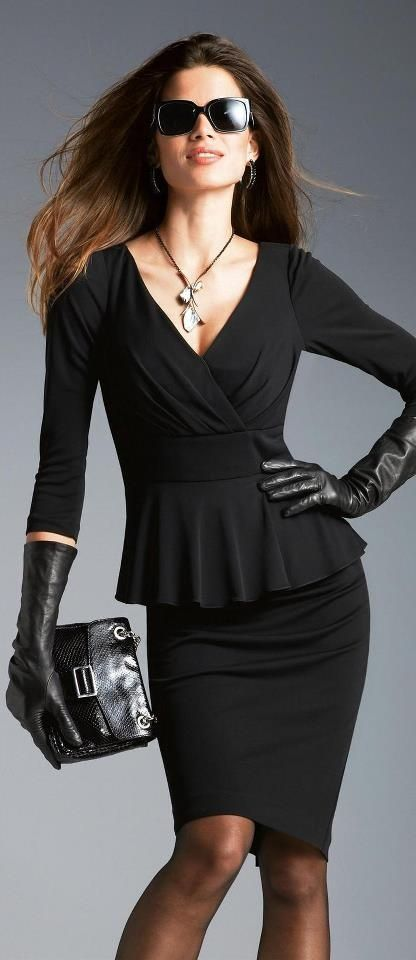 Chic Professional Woman Work Outfit. Black suit with peplum jacket. This will take you to a business meeting dinner afterward.