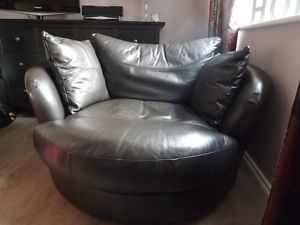 Leather brownblack DFS swivel cuddle chair Cuddle chair