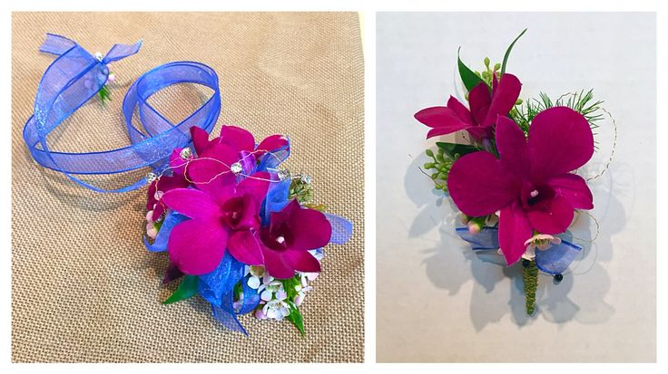 Homecoming corsage and boutonnière with magenta orchids, soft pink wax flower, silver wire, diamonds, and blue ribbon.
