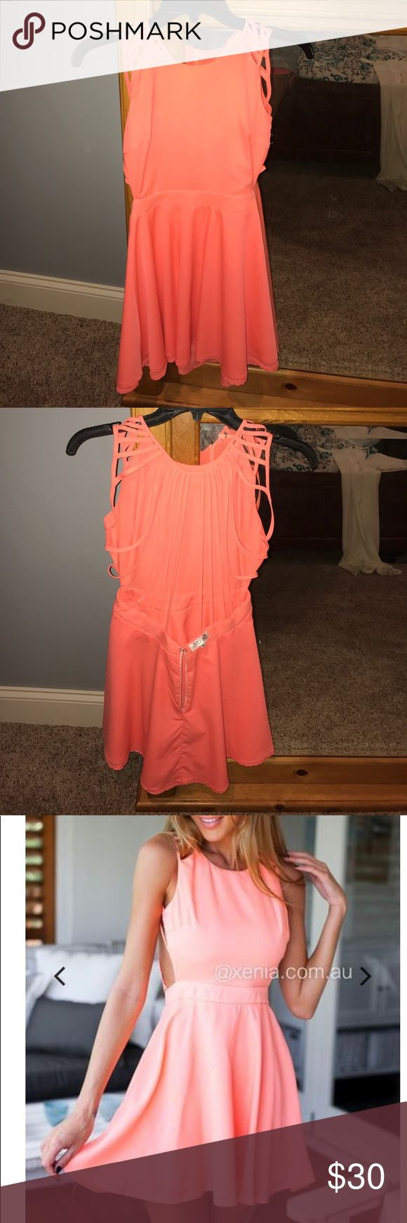 Coral open back dress Good material. The color is really nice and it fits super well. It's a small and fits me perfectly I'm 5'4 and 130lbs. It's not super short so no worries! Selling it for $10 less than original price. Only worn once! Ps it says it's an 8 only because it's from Australia. It's a six here in the US Xenia Boutique Dresses Backless